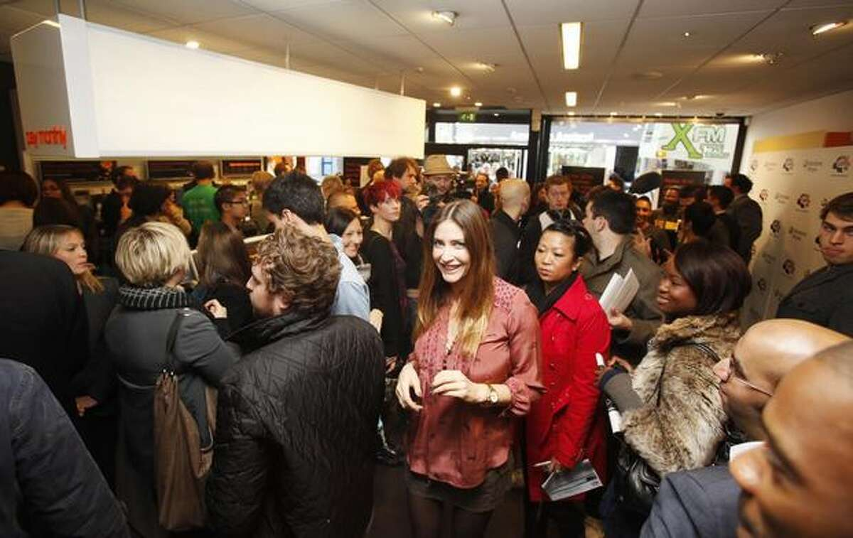 English model Lisa Snowdon waits with the crowd at the Windows Phone 7 launch at the Orange Shop Oxford Street on Thursday in London. (David Parry/PA Wire)