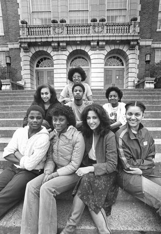 The April 1982 photo caption read: Students at Roosevelt High School may join the Ethnic Students Union, but may not form a separate black group. Towanna Robinson, at right in the back row, says such a group would give blacks a palce to air their grievances, among other things. Others are, from left in front, Mark Davis, Darlene Wood, Bonnie Glenn, and Angie Allen. From left in back are Phyllis Cravens, Ernest Allen III, Miriam Grimes, and Robinson. Photo: P-I File