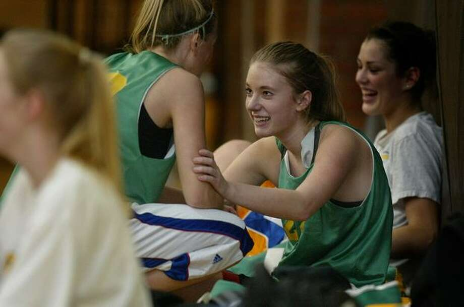 Molly Boyd, center, talks with teammate Alex Capeloto at a January 2006 basketball practice. Though she didn't get much playing time, teammates said Boyd was the soul of the Roosevelt team. Read more here. Photo: P-I File