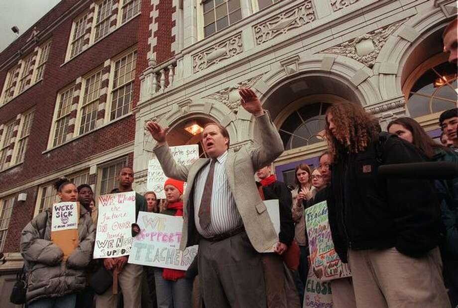 The March 1999 photo caption read: Kyell Rye teacher at Garfield High school tells a group of teachers in front of him and students behind about the need for higher salaries for teachers in public schools. Photo: P-I File
