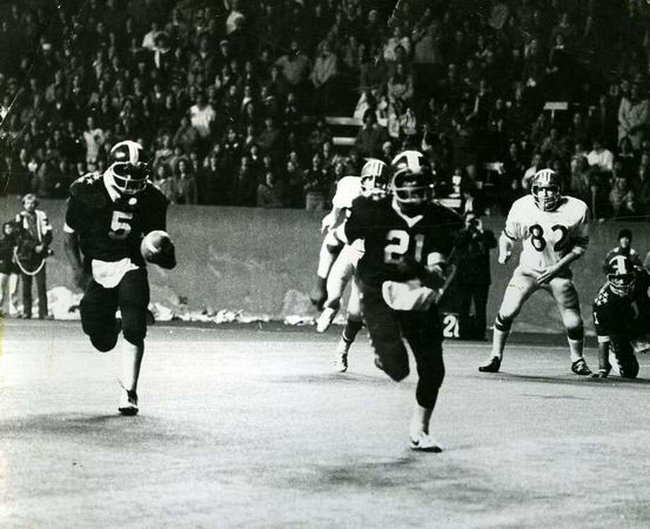 Garfield junior Kevin Powell (5) is pictured in the 1975 Metro League championship game against Blanchet, considered by many as Seattle's greatest ever high school football game.  Photo: P-I File