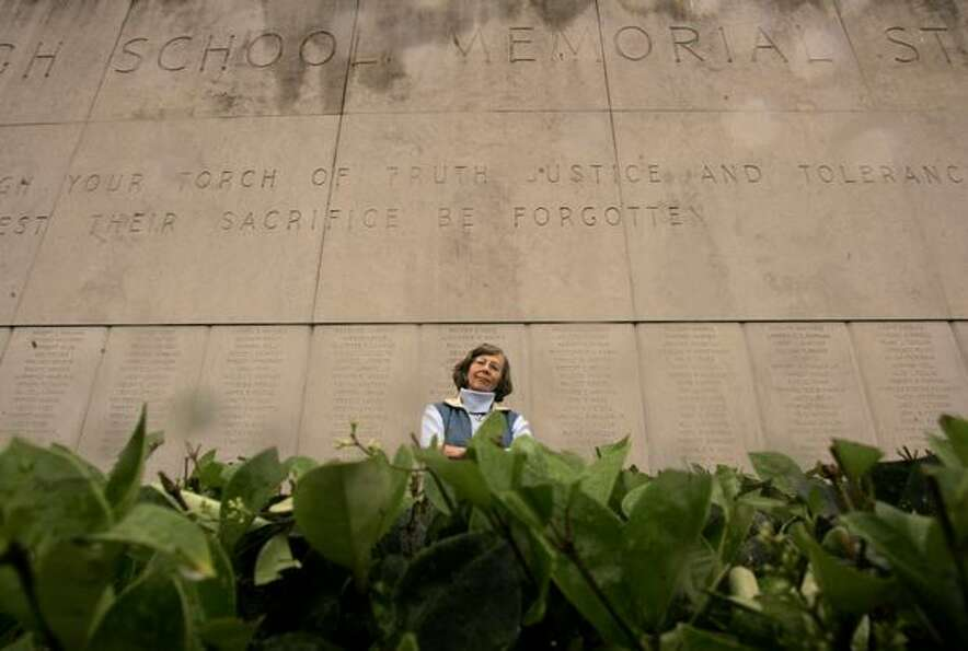 Marianne Hanson stands in front of the memorial wall at Memorial Stadium in Seattle Center, May 28,