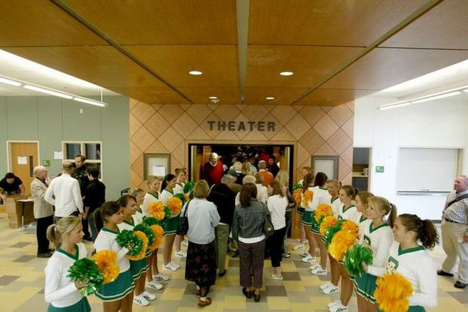 The 2006 photo caption read: Roosevelt cheerleaders line the entry into the new theater at the restored Roosevelt High School as it was dedicated on Wednesday, August 30. The $93.8 million project, under construction for the past two years, was made possible by voter approval of the $398 million Building Excellence II capital levy in February 2001. Photo: P-I File
