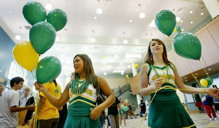 The September 2006 photo caption read: Cheerleaders Elise Hansen (left), a junior, and Fiona Gleason, a senior, hand out balloons during freshman orientation at the newly renovated Roosevelt High School. Photo: P-I File
