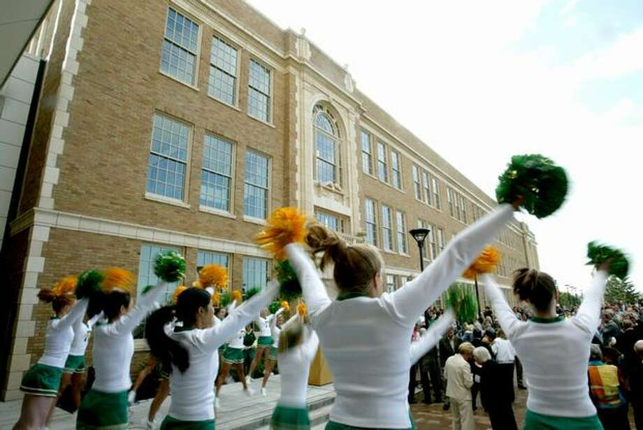 Roosevelt High School cheerleaders welcome guests to  their renovated school in 2006. Photo: seattlepi.com archive. Photo: P-I File