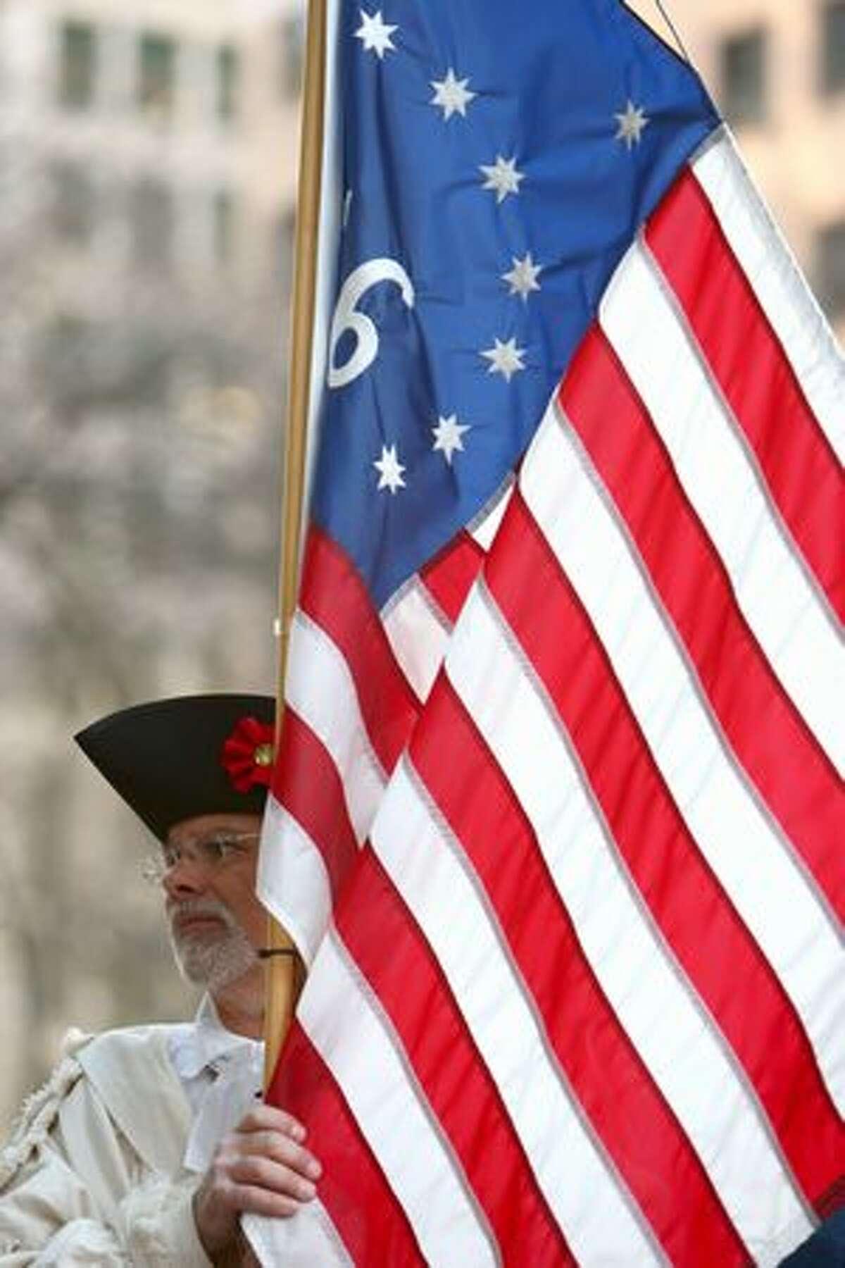 A participant holds a flag.