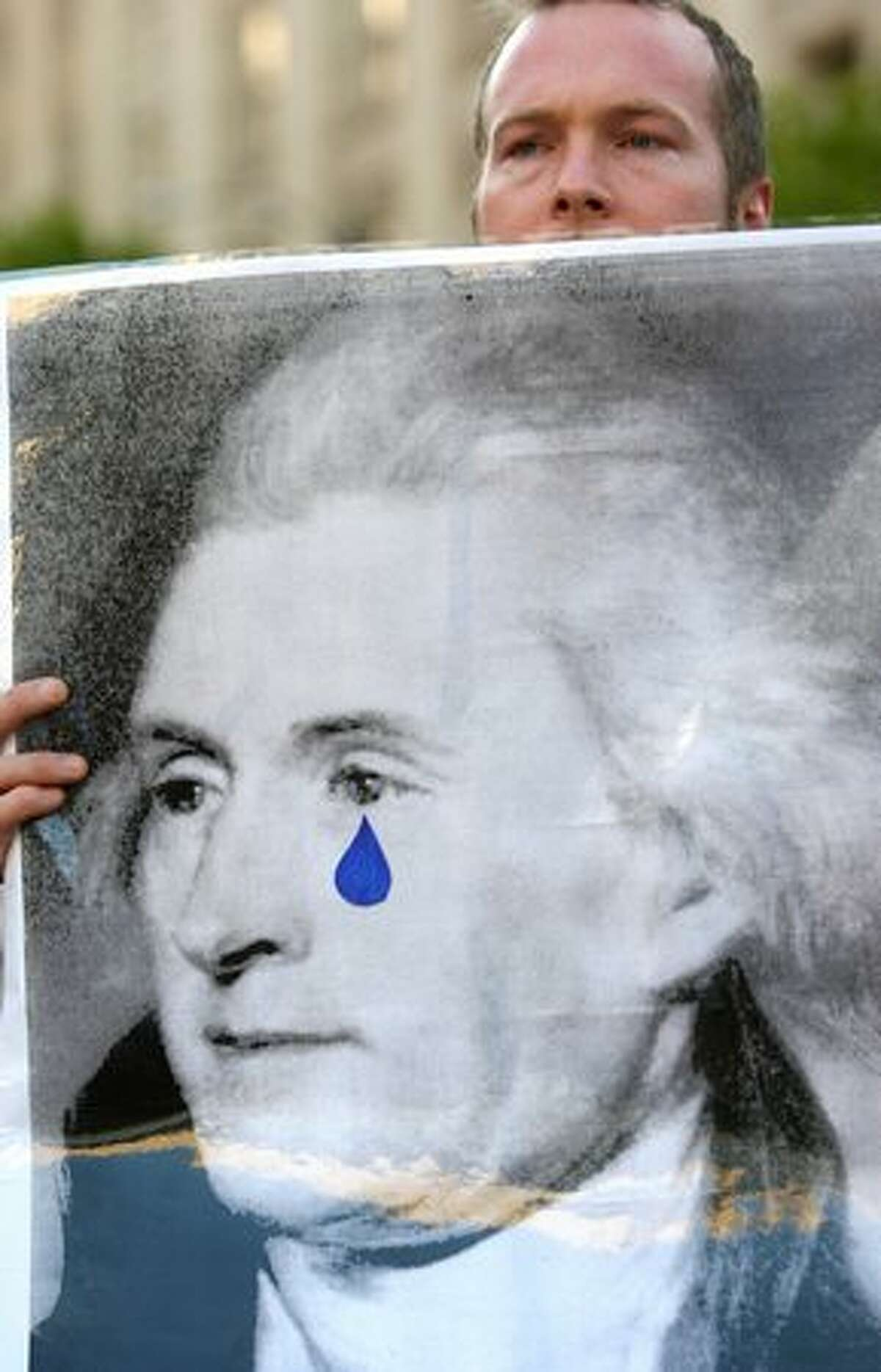 Mark Martin holds a portrait of Thomas Jefferson.