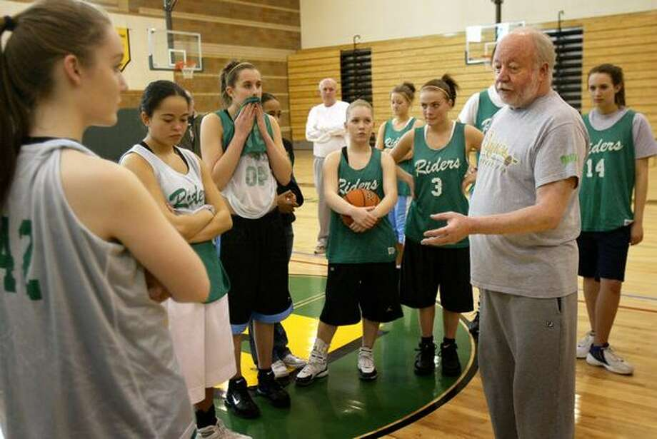 "Roosevelt High School girls basketball coach Bill Resler talks with his team as practice wraps up, Feb. 26, 2007. Under Resler's tenure, Roosevelt won the 2004 Class 4A state championship and made several trips to the state tournament. Resler and his players were the subject of a documentary ""The Heart of the Game."" He also wrote a book, ""The Heart of the Team,"" with P-I reporter Casey McNerthney. Photo: P-I File"