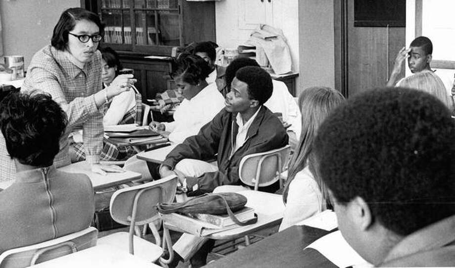 The December 1968 photo caption read: Mrs. Beatrice Hudson, member of ad hoc committee for central area school council, tells students of a life sciences class at Garfield High of hopes to elect a council instead of accepting one appointed by Seattle School District. Photo: P-I File