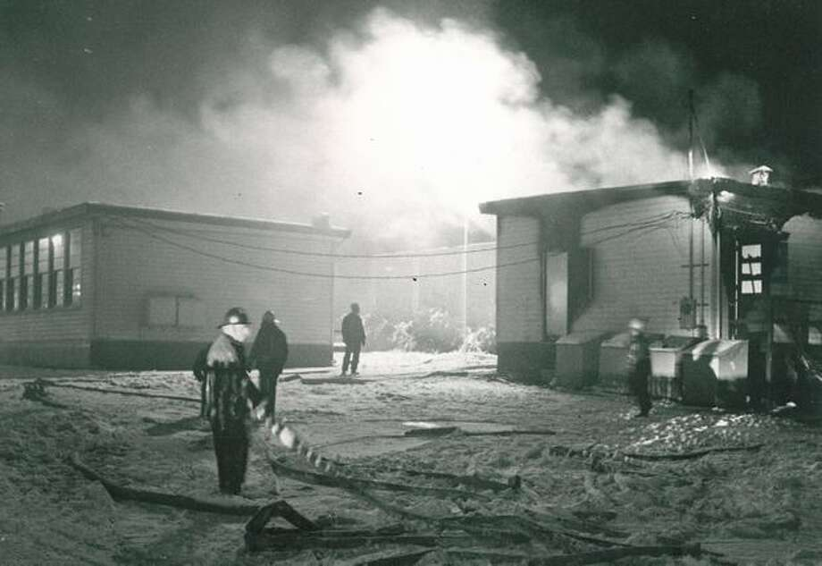 "The December 1972 photo caption read: Smoke and flames lit up the night sky at Garfield High School ""B"" Tuesday night. The third blaze set in building in a month caused $12,200 damage and destroyed a portable classroom. Photo: P-I File"