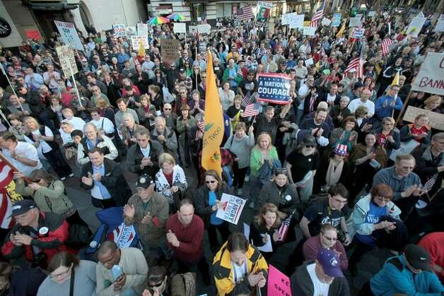 The Tea Party movement at high tide invades downtown in very-Democratic Seattle.  Photo: Joshua Trujillo, Seattlepi.com