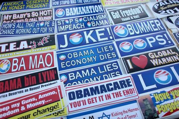 Anti-Obama, anti-health care reform stickers for sale at 2010 Tea Party rally.  The movement's extremism, and Mitt Romney's pandering to it, may help reelect President Obama. Photo: Joshua Trujillo, Seattlepi.com