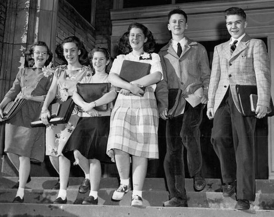 The January 1947 photo caption read: These smiling youngsters are the smallest entering freshman class ever at Garfield High School. Shown leaving McGilvra School they are, left to right, Marilow Nyquist, Emilyjean Whetsone, Joyce Babcock, Ruth Ostrow, Ronald Requa and Allan Carey. Photo: P-I File
