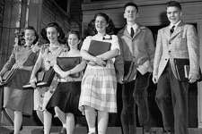 The January 1947 photo caption read: These smiling youngsters are the smallest entering freshman class ever at Garfield High School. Shown leaving McGilvra School they are, left to right, Marilow Nyquist, Emilyjean Whetsone, Joyce Babcock, Ruth Ostrow, Ronald Requa and Allan Carey.