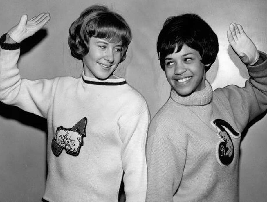 The November 1964 photo caption read: Sue Hagen, left, and Barbara Lavert root against old schools. Photo: P-I File