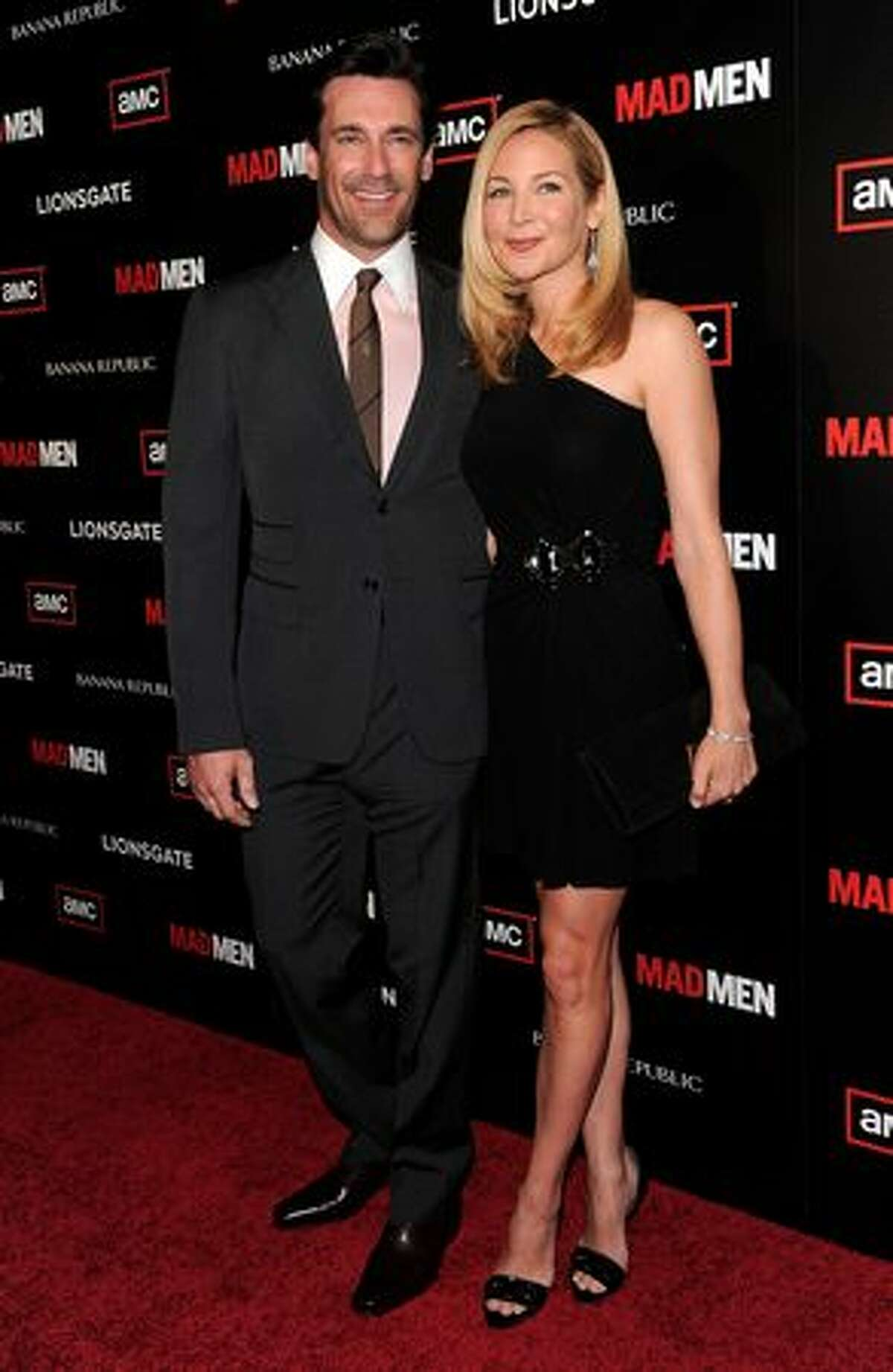 """Actor Jon Hamm, who stars as Don Draper in """"Mad Men"""", poses with his longtime girlfriend, actress Jennifer Westfeldt, at the show's season 4 premiere in Hollywood, California."""