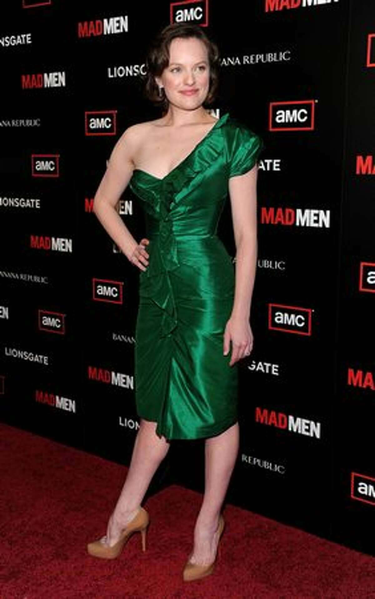 """Actress Elisabeth Moss, who plays Peggy Olson on """"Mad Men"""", arrives to the show's season 4 premiere in Hollywood, California."""