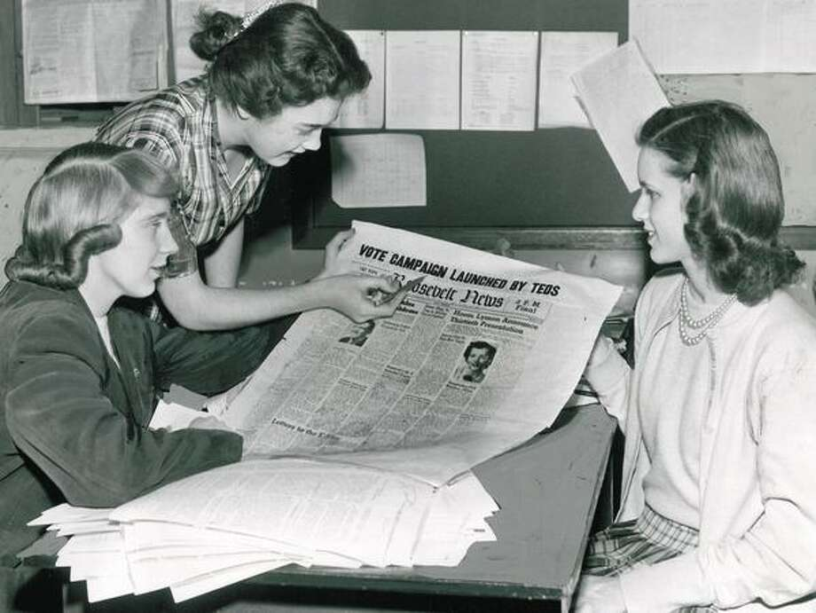 "The March 1952 photo caption read: Lanae Spurgin, left, Janet Stone and Sally Schneider, editors of the Roosevelt News, discuss plans for their Tuesday issue, in which the school newspaper will encourage parents to ""get out and vote"" in the Tuesday municipal election. Photo: P-I File"