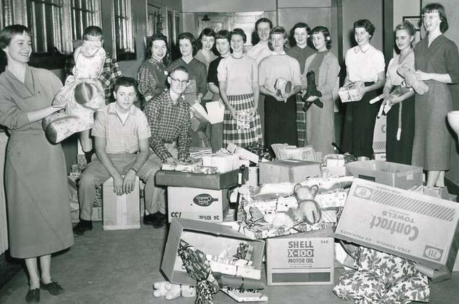 The December 1957 photo caption read: Packages of presents, part of Roosevelt High School's annual C