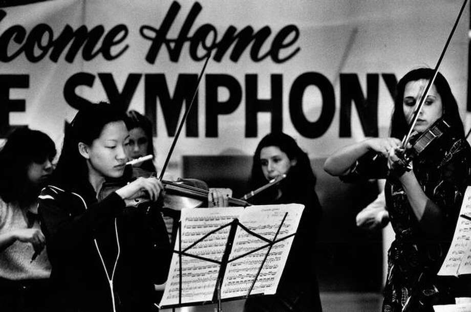 The April 1980 photo caption read: Roosevelt High School's chamber orchestra gives a warm welcome home to the Seattle Symphony Orchestra yesterday. Photo: P-I File