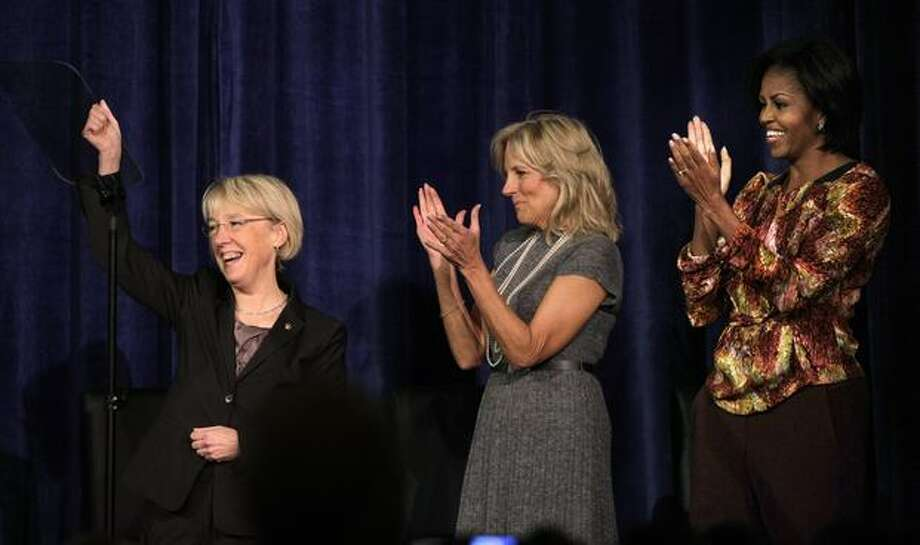 First lady Michelle Obama, right, cheers Sen. Patty Murray, left, with Jill Biden at a Senate campaign fundraiser Monday in Bellevue. Mrs. Obama is the latest high-profile Democrat coming to help out Murray, who's in a competitive race with Republican Dino Rossi. Photo: Elaine Thompson, Associated Press