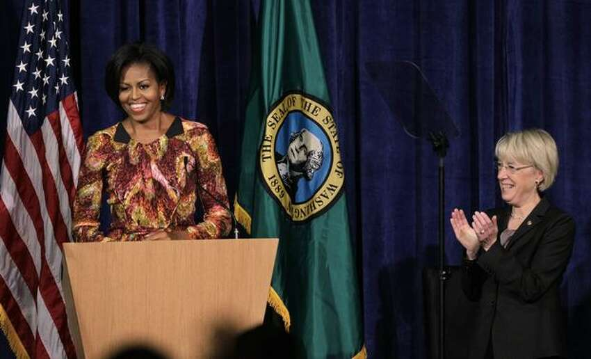 First lady Michelle Obama, left, is cheered Sen. Patty Murray at a Senate campaign fundraiser in Bellevue.