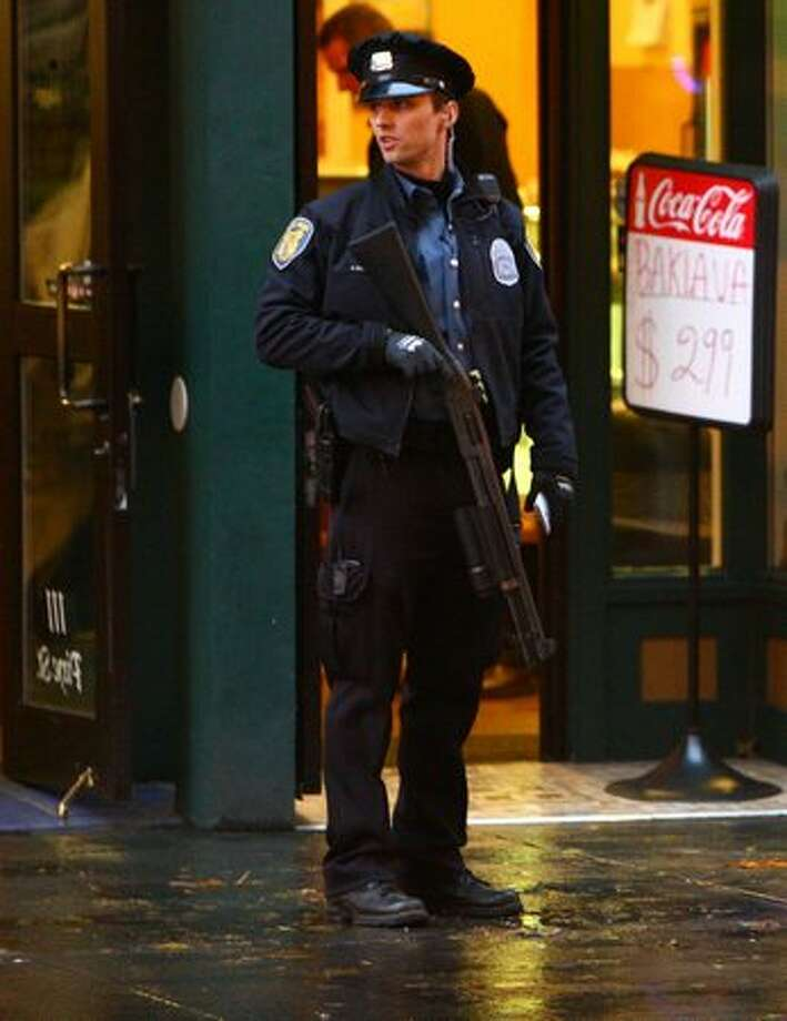 Seattle Police secure the scene after a man was shot in the head at the intersection of Second Avenue and Pike Street in downtown Seattle on Tuesday. Photo: Joshua Trujillo, Seattlepi.com