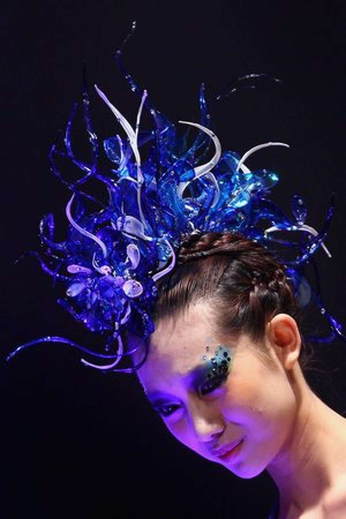 A model walks the runway during the EONFASHION AWARD 2011 China Fashion Week Make-up Styling Contest on the first day of China Fashion Week Spring/Summer 2011 in Beijing, China.