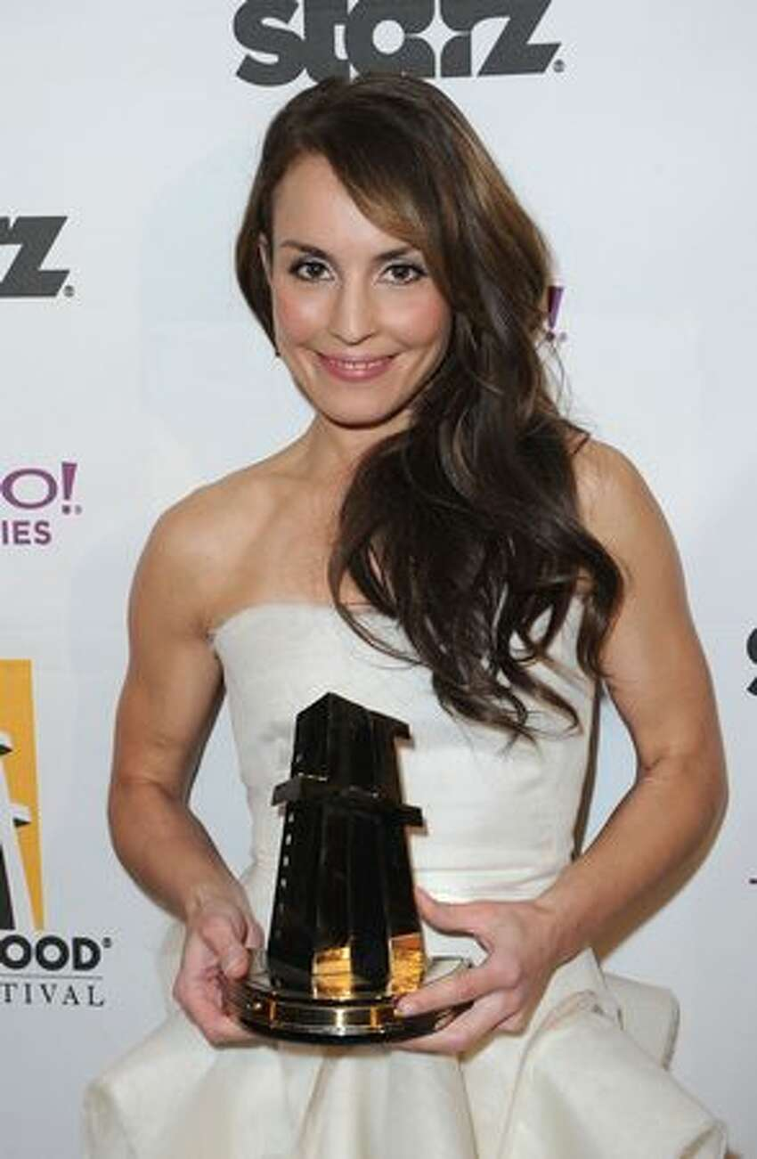 Actress Noomi Rapace poses with the Hollywood Spotlight Award during the 14th annual Hollywood Awards Gala at The Beverly Hilton Hotel in Beverly Hills, California.