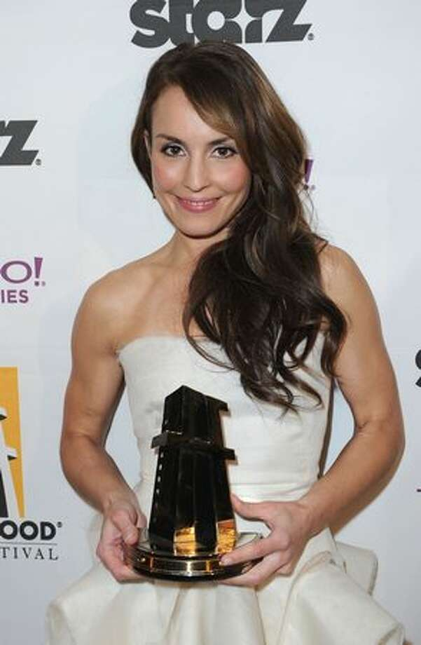 Actress Noomi Rapace poses with the Hollywood Spotlight Award during the 14th annual Hollywood Awards Gala at The Beverly Hilton Hotel in Beverly Hills, California. Photo: Getty Images