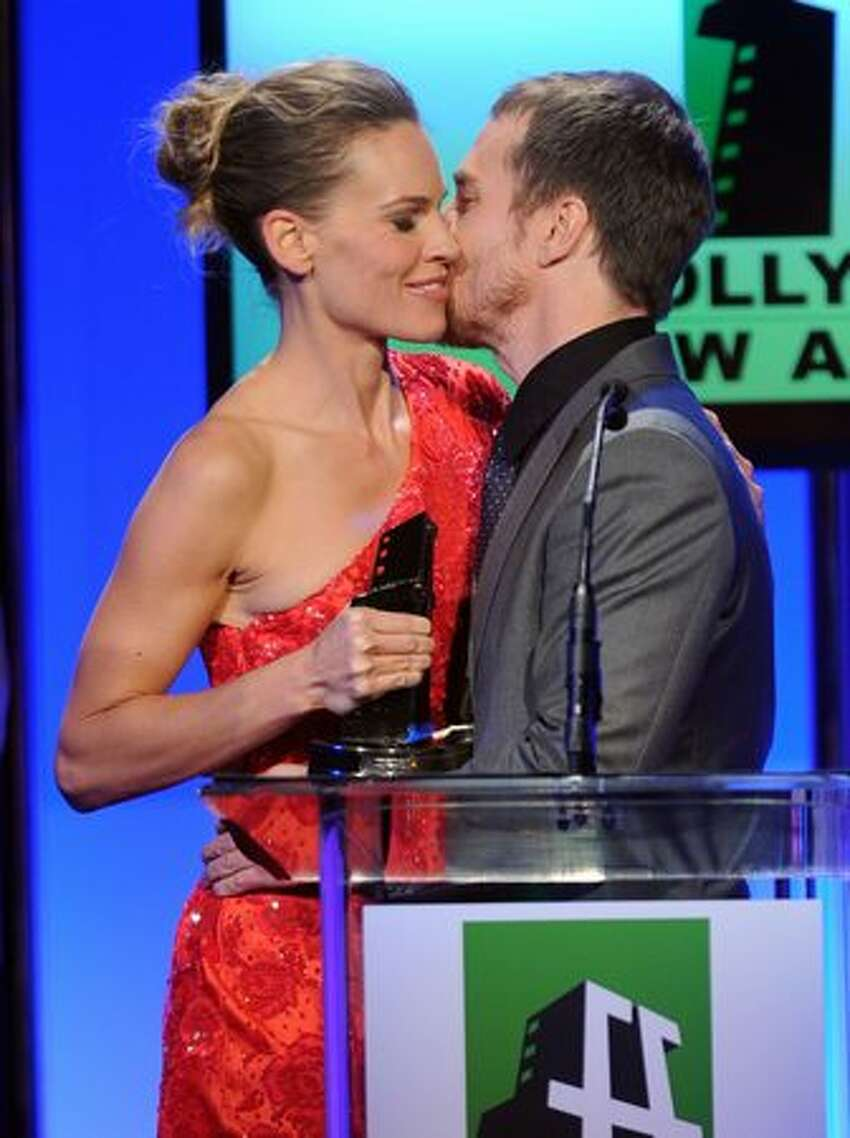 Actress Hilary Swank presents the Hollywood Supporting Actor Award to actor Sam Rockwell onstage during the 14th annual Hollywood Awards Gala in Beverly Hills, California.