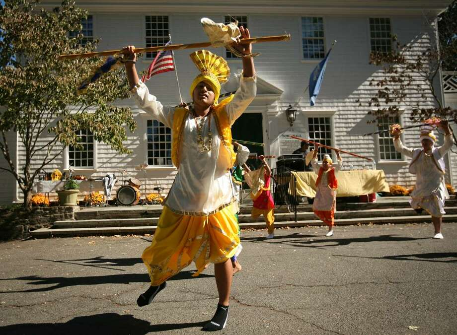 Yuvraj Singh of Wilton leads a group of dancers in the Bhangra, a traditional folk dance from Punjab, India, at the annual Heritage India Festival on the Fairfield Town Hall Green on Sunday, September 20, 2009 in Fairfield, Conn. Photo: Brian A. Pounds / Connecticut Post