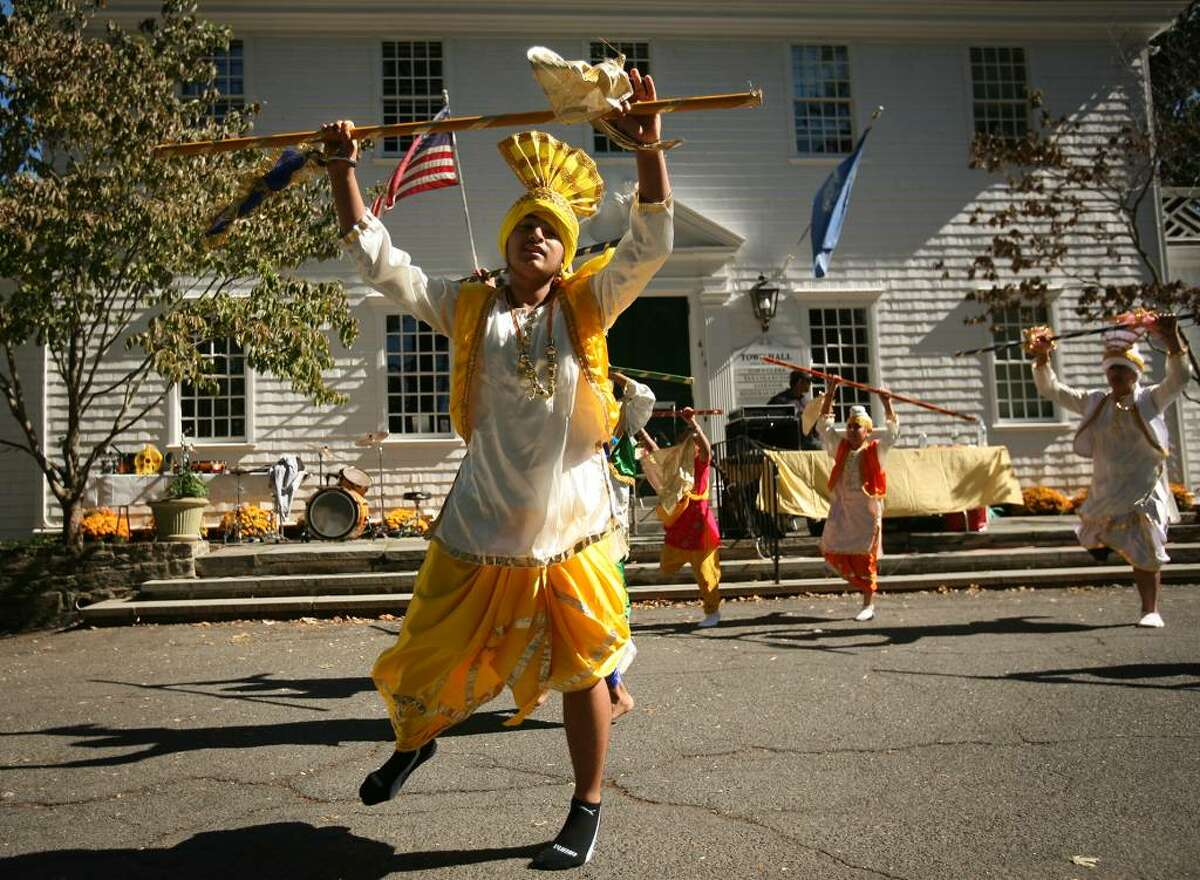 Yuvraj Singh of Wilton leads a group of dancers in the Bhangra, a traditional folk dance from Punjab, India, at the annual Heritage India Festival on the Fairfield Town Hall Green on Sunday, September 20, 2009 in Fairfield, Conn.