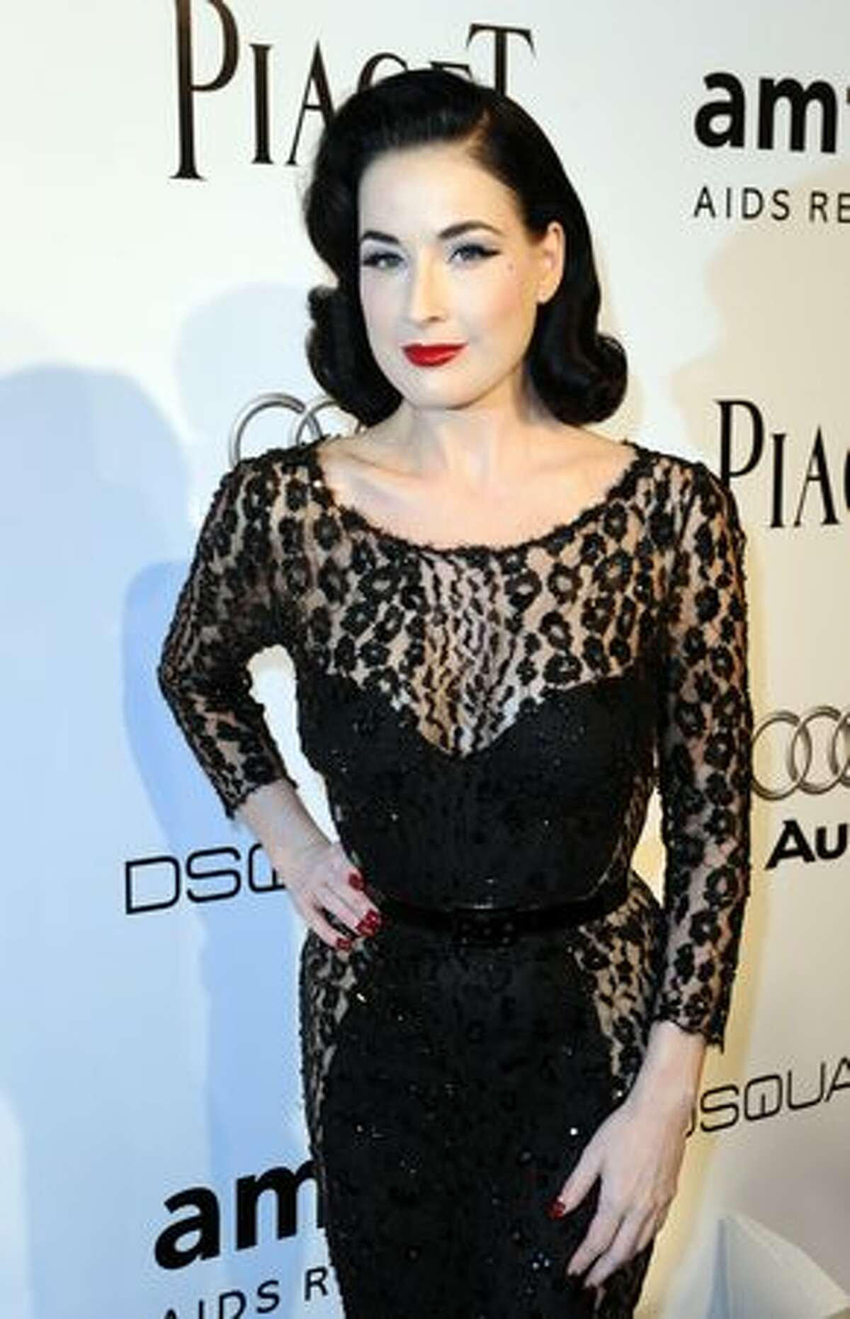 Dita Von Teese arrives at the amfAR's Inspiration Gala Los Angeles to benefit the Foundation's AIDS research programs at the Chateau Marmont in Hollywood, California.