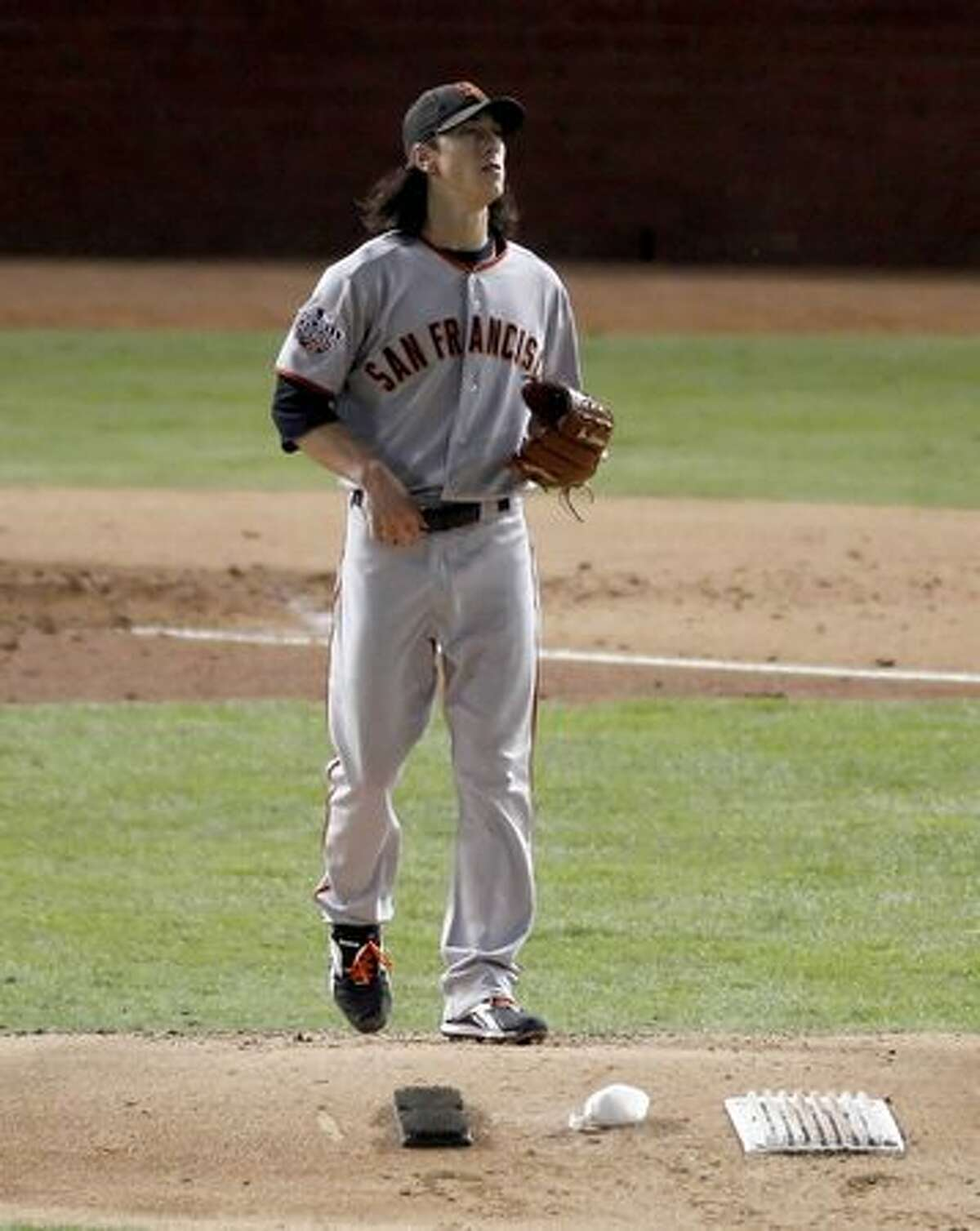 San Francisco Giants starting pitcher Tim Lincecum (55) returns to the mound after striking out Bengie Molina in the third inning during game 5 of the 2010 World Series between the San Francisco Giants and the Texas Rangers on Monday in Arlington, Tx.
