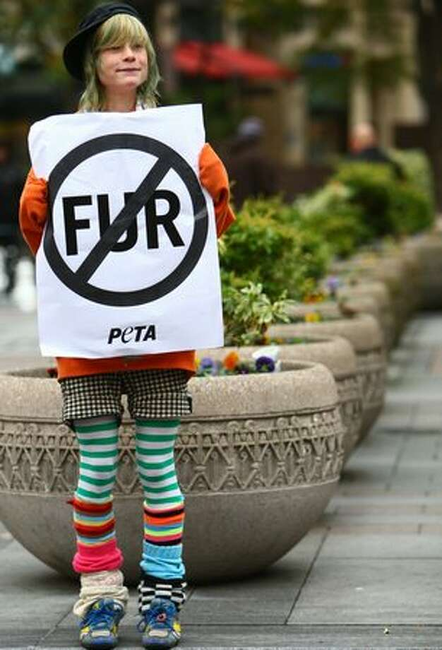 "Kyana ""Kitty"" Jones supports PETA activists during a PETA protest on Friday at Westlake Park in Seattle. Photo: Joshua Trujillo, Seattlepi.com"
