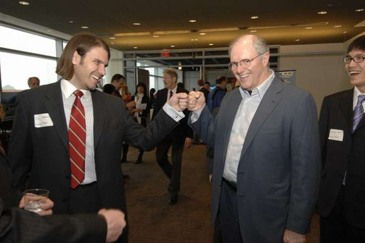 Microsoft's Craig Mundie bumps fist with U.S. Imagine Cup competitor Cal Coopmans of Utah State University at the Newseum in Washington, D.C. (Microsoft photo)