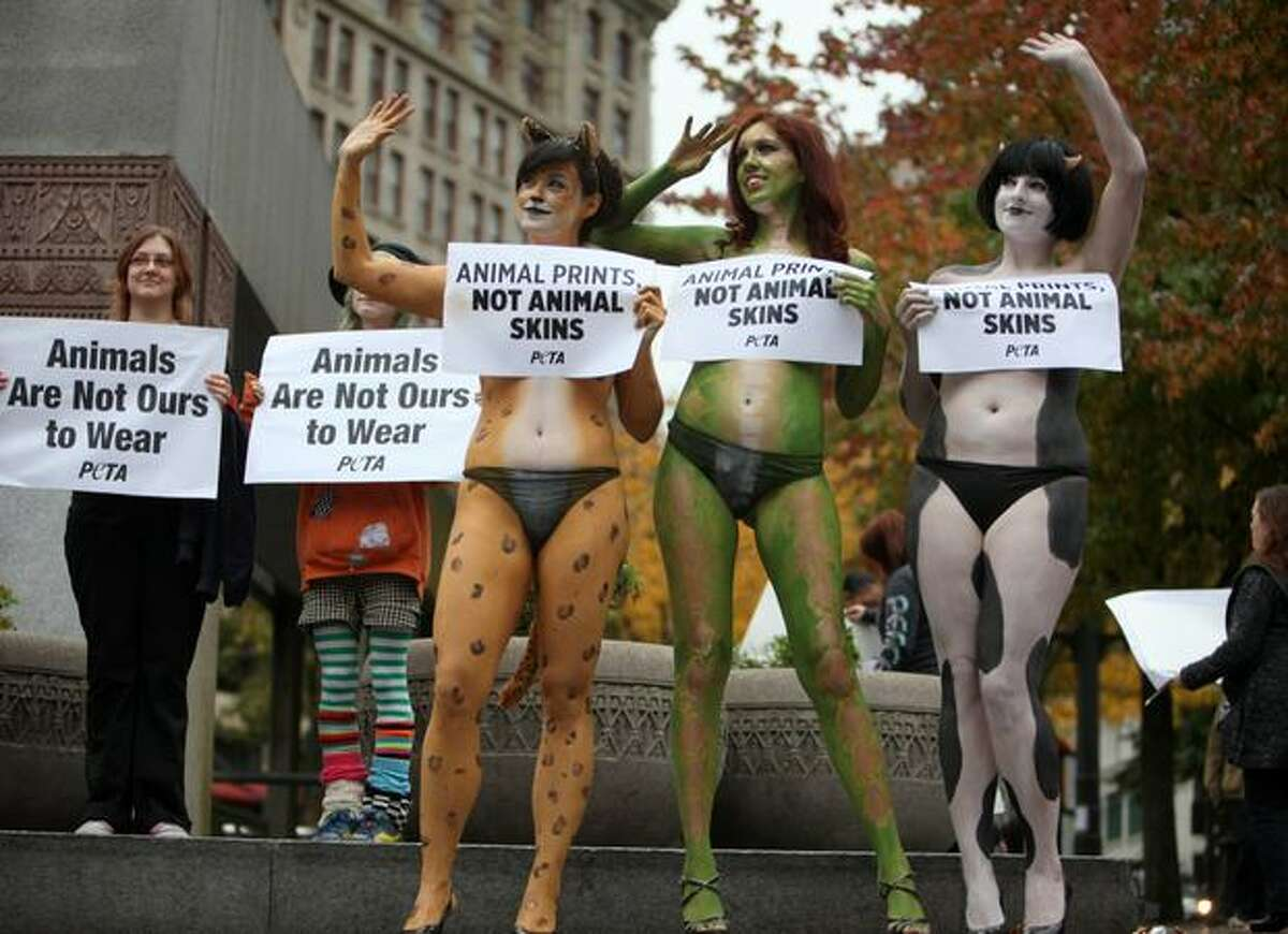 PETA activists, from left, Tricia Harris, Meggan Anderson and Amber Tegantvoort show some human skin to bring attention to the use of animal skin in clothing during a PETA protest on Friday, November 5, 2010 at Westlake Park in Seattle. The women, and a group of supporters, surprised passersby with their display.