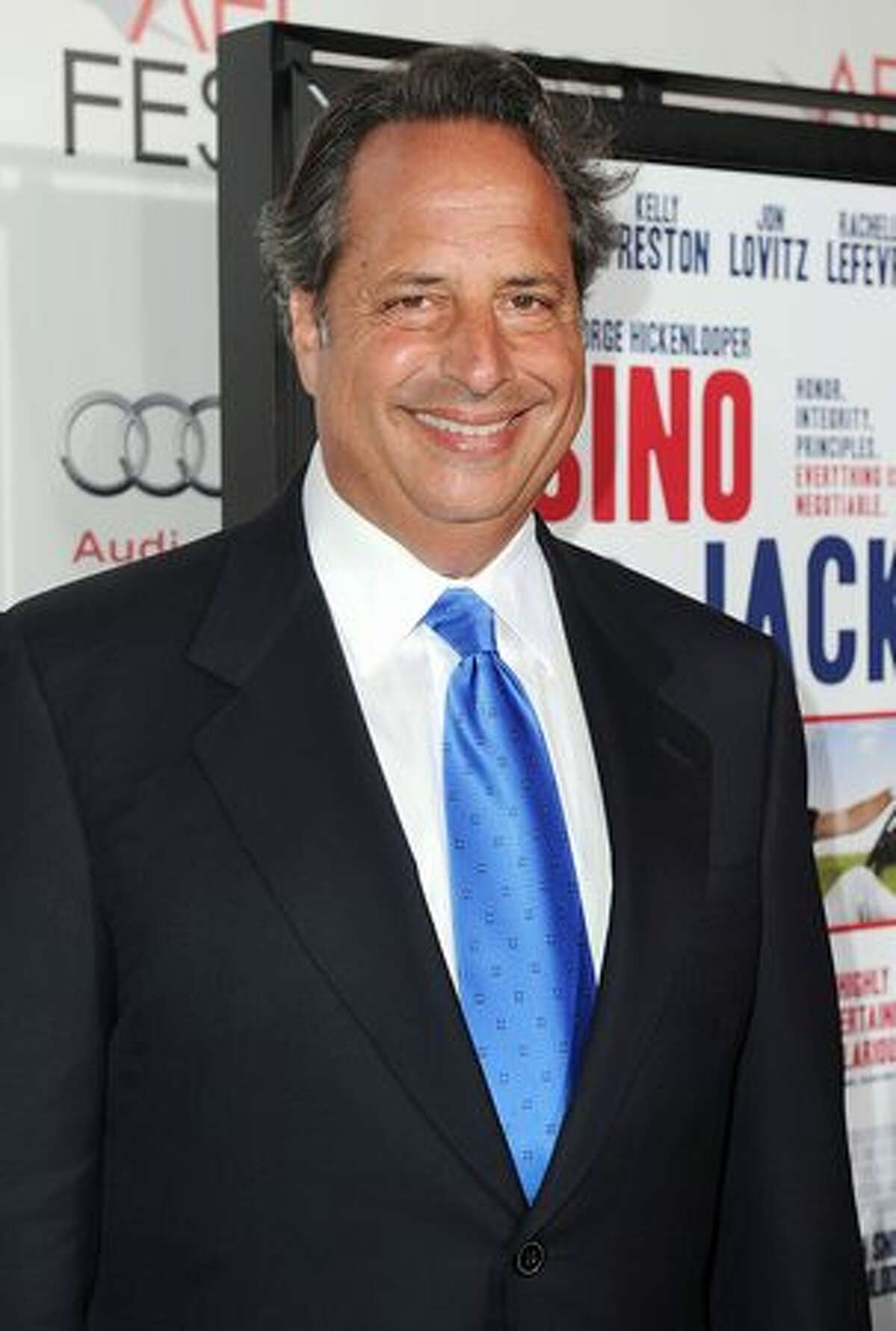 Actor Jon Lovitz arrives.