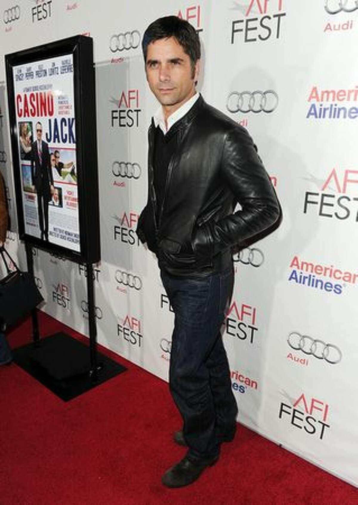 Actor John Stamos arrives.