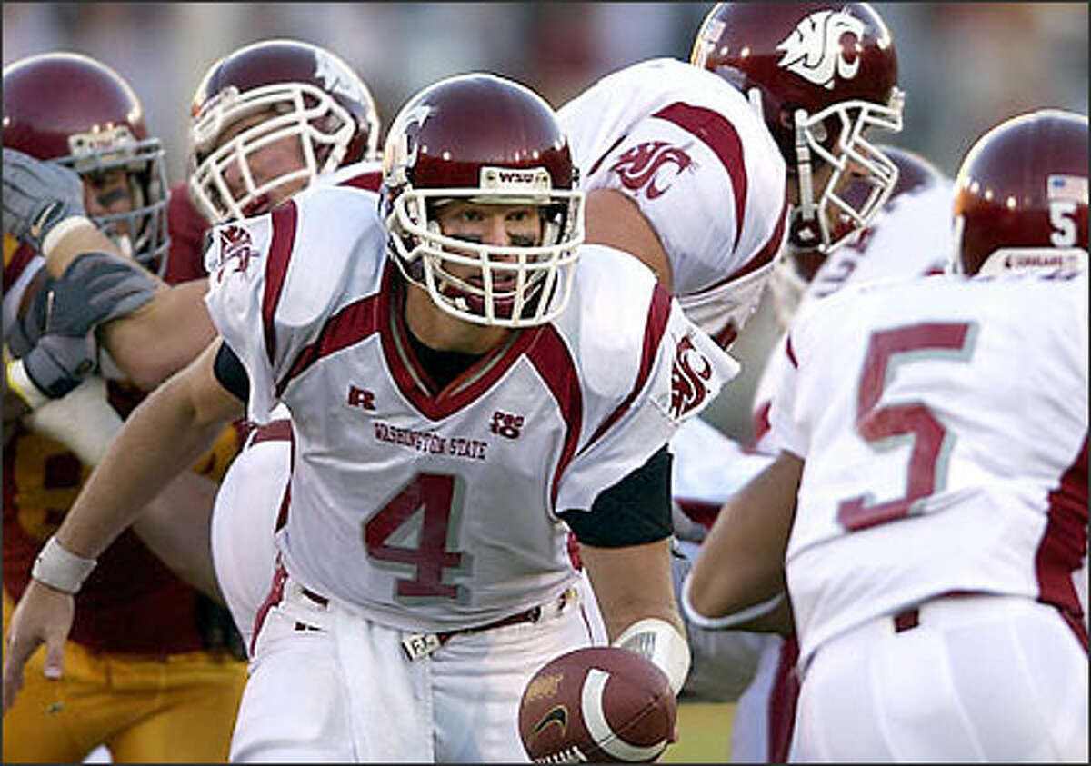 Washington State quarterback Matt Kegel gets set to hand off to Jonathon Smith during the first half against Southern Cal, Saturday night, Nov.1, 2003, in Los Angeles. (AP Photo/Mark J. Terrill)