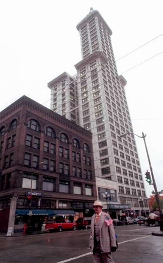 The October 1996 photo caption read: Big plans are in the works for renovation programs for the Collins Building, Pioneer Square Theater and the Smith Tower. Photo: P-I File / P-I File