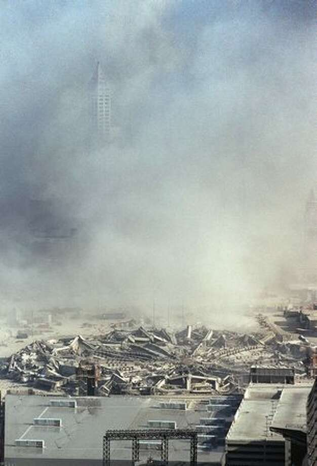 Smith Tower peaks out from the dust after the 2001 implosion of the Kingdome. Photo: P-I File / P-I File