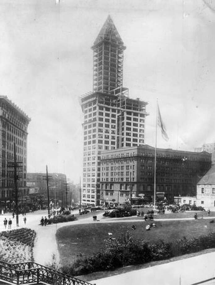 L. C. Smith surprised the city when he announced plans for a $1.5 million office building on the corner of Second Avenue and Yesler Way. When it was completed in 1914, the 42-story Smith Tower was the tallest building west of the Mississippi River. This picture was taken in 1912 looking across City Hall Park. (Seattlepi.com file/Museum of History and Industry) Photo: P-I File / P-I File