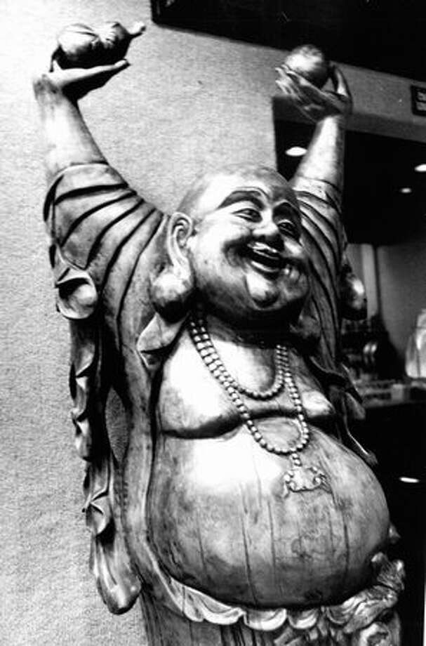 A Buddhist figure in the Smith Tower restaurant lobby, Nov. 26, 1978. Photo: P-I File / P-I File