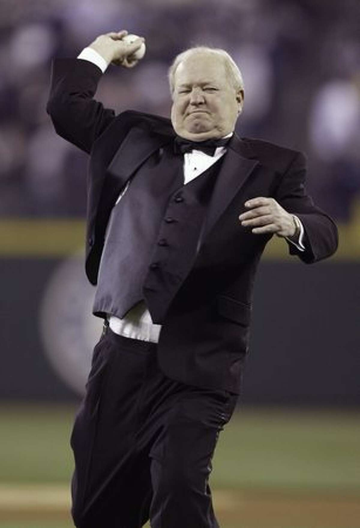 Seattle Mariners play-by-play announcer Dave Niehaus throws out the ceremonial first pitch prior to the Mariners' Home Opener against the Texas Rangers on March 31, 2008 in Seattle, Washington. The Mariners defeated the Rangers 5-2.