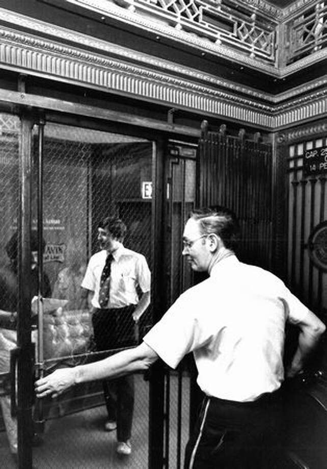 The Aug. 13, 1979 photo caption read: Lawrence Rodgers has had his ups and downs for 17 years. The Smith Tower elevator operator is one of a vanishing breed. Photo: P-I File / P-I File