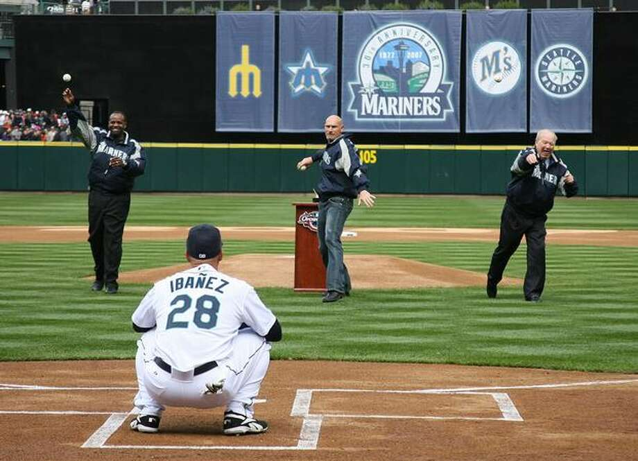 Former Mariners Alvin Davis, Jay Buhner, and team announcer Dave Niehaus of the Seattle Mariners throw out the ceremonial first pitch of the game on opening day against the Oakland A's at Safeco Field April 2, 2007 in Seattle, Washington. Photo: Getty Images / Getty Images