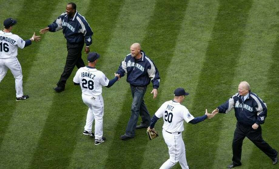 Seattle Mariners from left, Willie Bloomquist (16) Raul Ibanez (28) and J.J. Putz (20) shake hands with Alvin Davis, Jay Buhner and Dave Niehaus after the trio threw out the ceremonial first pitch at Safeco Field on Monday, April 2, 2007. Photo by Joshua Trujillo / Seattle Post-Intelligencer