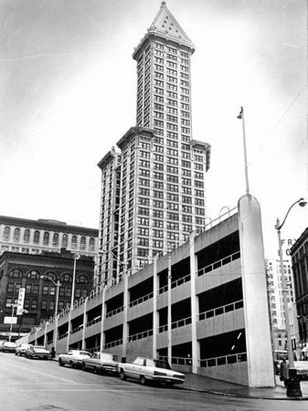 The Smith Tower photographed with the sinking ship parking garage, March 27, 1975.